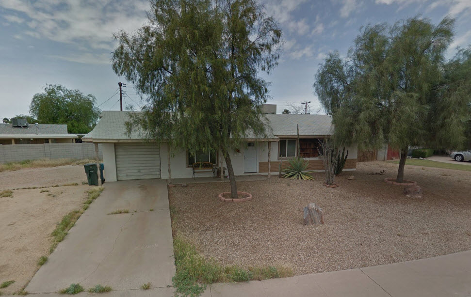 House is in rental ready condition with an enormous corner lot.